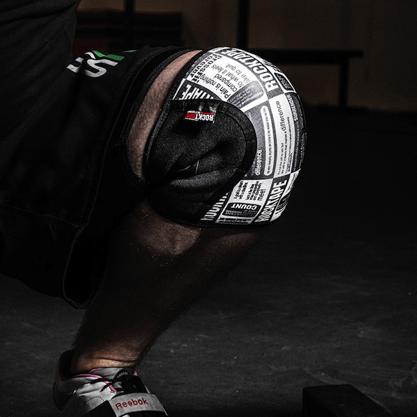 Squatting in Rocktape knee caps